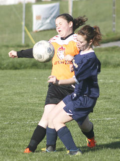 Tyrsten Cummins, right, collides with Olivia Souder, left, as they were going for the ball.