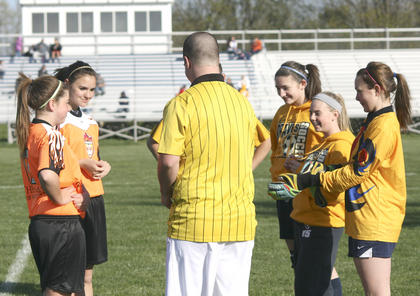 Williamstown Middle School and Grant County Middle School met up for the first time in soccer April 10. Here, Karyna Davis and Sammie Souder of WMS greet Kaylie Ezell, Kelsey Lund and Sierra Schmitt to flip the coin before the game.