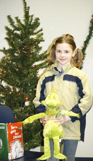 Sydney Adams, 9, of Crittenden, won a stuffed Grinch in a drawing at the library.