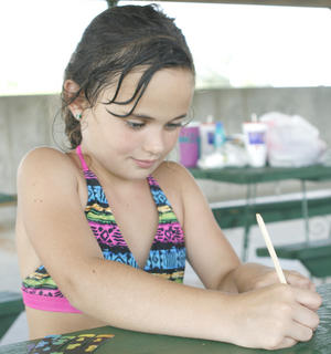 Taleah Dalton works on a craft project.