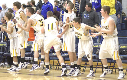 The bench jumps in excitement after securing the win over Walton-Verona. 