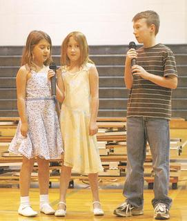 Siblings Trenton, Hayley and Hannah Faulkner performed a trio and sang, &quot;By Your Side.&quot;