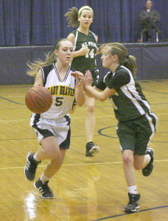 Seventh grader Tianna Thornberry drives the lane against a St. Pius defender.