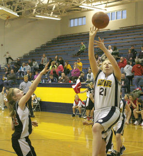 Sixth grader Tori Moore jumps for the shot against Conner Middle School.