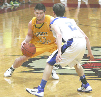 Trevor Hunt dribbles the ball up the court during the first half against Oldham County March 1, at Henry County High School in New Castle.