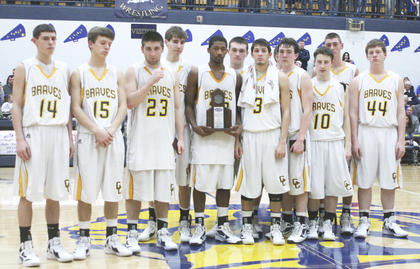 The team accepts their trophy for district runner-up after the game Feb. 24