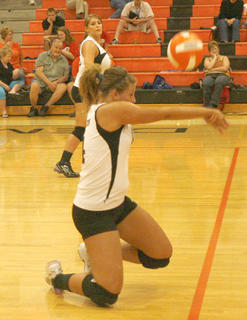Lady Demons junior Morgan Potter gets low for the hit.