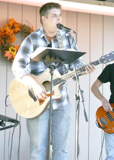 Wes Cain, youth pastor at Christ Community Church, sings with the praise band.