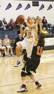 Eighth grade guard Macy Wright goes up for a layup against Williamstown Jan. 24.