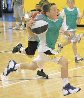Wyatt Gatewood, 10, of Dry Ridge, drives the lane during the 2nd Annual Future Stars Basketball Camp at Grant County High School.