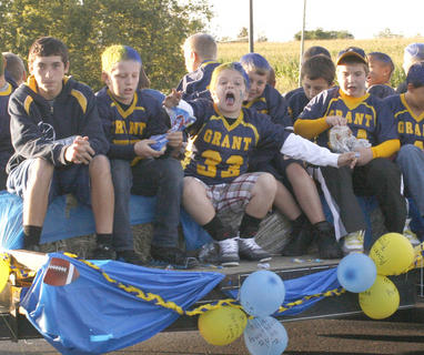 Youth football team members show some enthusiasm.