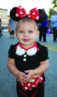 Autumn Tolle dresses up as Minnie Mouse for the Fall Fest on Main in Williamstown held Oct. 20.