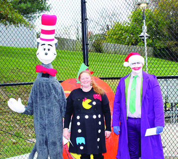 ADULT  - Scott Lecates, Cat in the Hat - Judge's Choice; Angela Hatter, Ms. Pac Man - Most Original and Barry Robinson, Joker - Spookiest. Photos by Camille McClanahan