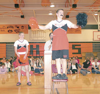 Matt Lillard, shows his cheerleading skills when being auctioned off during the Williamstown High School Senior Service Auction. 
