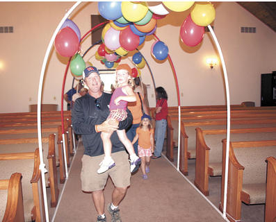 Doug Bradley walks down the aisle with Carlie Jo Dupuy during Vacation Bible School.