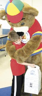 Graham Butler gives Bearamy a big hug.