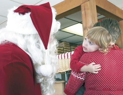 Bianca Dills wasn't sure about a visit with Santa at Edward's in Williamstown on Dec. 18.