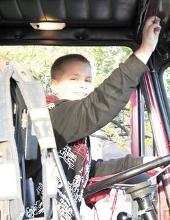 Daniel Meredith, fifth grade, decided to blow the horn on the fire truck.