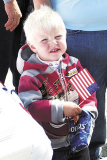 Colton Manning shows his patriotism by waving the American Flag at the Senior Bash on Sept. 20. 
