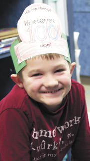 Caleb Richardson sports a big smile and a homemade hat as he celebrates the 100th day at Sherman Elementary.