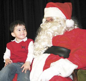 Joshua Webster, age 2, of Dry Ridge was not afraid of Santa. He is the son of Dee and David Webster.