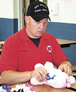 Brandon Voet of the Dry Ridge Fire Department stuffs a bear.