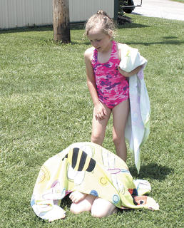 Emily Phillips plays hide and seek from C.C. Gay during Little Dippers at Grant County Park
