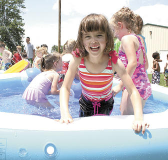 Audrey Shelton enjoys cooling off in the pool at Little Dippers Camp.