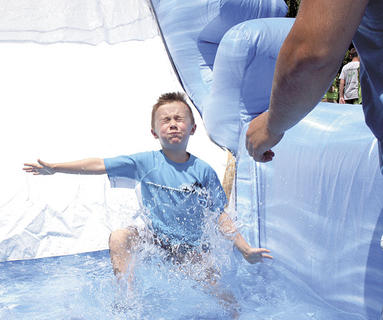 Jackson Utter splashes into the water at the end of the slide.