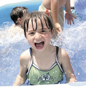 Nevaeh Rowe smiles while playing in the pool.