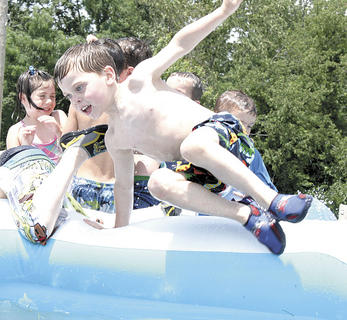 Samuel Deatheridge hops in the pool to cool off.