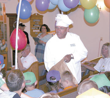 """Chef Pierre"" dishes out some treats for the children."