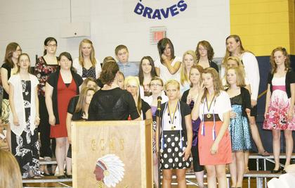 The GCMS choir prepares for a performance at the promotion ceremony.