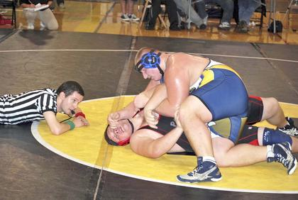 Cody Miskell tries to pin his opponent for the point.