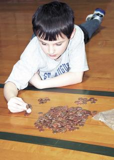 Garrett Mitchell is intent on counting coins as part of the penny war.
