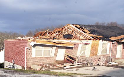 One of the nearly 100 homes with damage from the tornado in the Harvester&#039;s Subdivision.