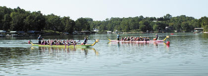 PADDLE WILLIAMSTOWN 2012 - Dragon Boats were a new addition to Williamstown's Paddle Fest. This year, the second for the event, brought 300 kayaks, canoes, paddleboards, water trikes and boats to the lake on Aug. 25 for a morning of fun, which included a poker paddle, scavenger hunt and visiting. Photos by Jamie Baker-Nantz