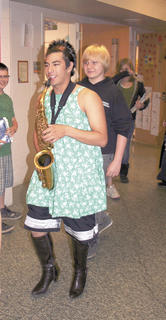 A SWEET SONG - Mu Sunayama had to wear a dress and high-heels to perform on his saxophone.