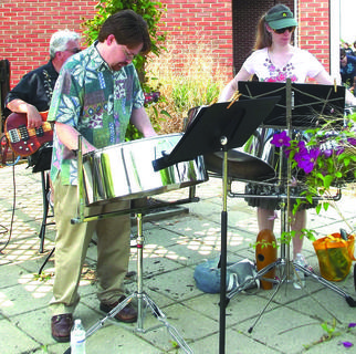 A Bacchanal steel drum band performs at the summer reading event at the Grant County Public Library.