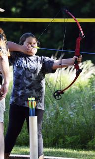Bronwen Sydnor concentrates on her target before shooting.
