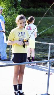 Kaitlyn Heist of Independence tries to catch a fish.