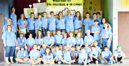 The 4-H Summer Camp staff and campers pose for a photo before their day begins. The 4-H Summer Camp was held on June 23 through June 27.