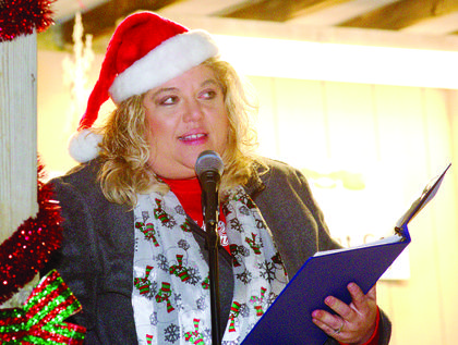 Grant County Chamber of Commerce executive director Jamie Baker dons a Santa hat as she talks to the crowd at A Country Christmas.