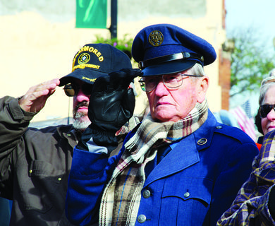 Don Crupper, a Korean War veteran, salutes during the Pledge of Allegiance.