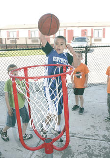 Teagan Moore shoots for a slam dunk at Williamstown Elemetary&#039;s track and field day.