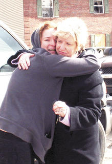 Carla Wiltsie and Ellen Heile were overcome with emotion on March 3 after seeing the havoc in Harvester's Subdivision. Heile owns the apartment building that sustained the most damage.