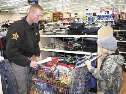 Grant County Sheriff's Deputy Matt Boshears assisted Cody during the Grant County Sheriff's Office/Williamstown Police Department's Annual Shop With a Cop program.