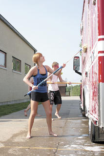 FIRE TRUCK WASHING - Kirsten Gray and William May put some elbow grease into cleaning Dry Ridge and Williamstown fire trucks.