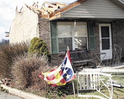 A flag blows in the breeze, a day after storms ravaged the Crittenden area.