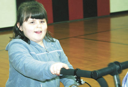 Gabriella Robinson, is ready for her turn on a bike.